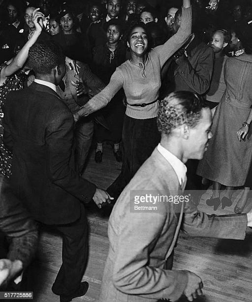 Black couples dance to swing in Harlem Nightclub early 1930's