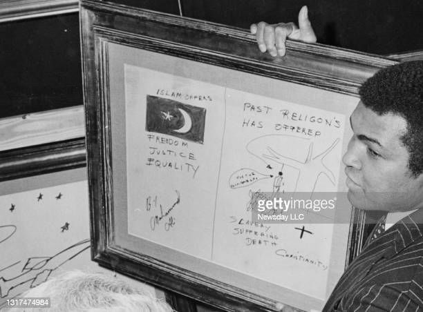 Boxer Muhammad Ali displays one of his paintings for the media at his world premier art exhibit at Roseland in Manhattan on January 29, 1979.