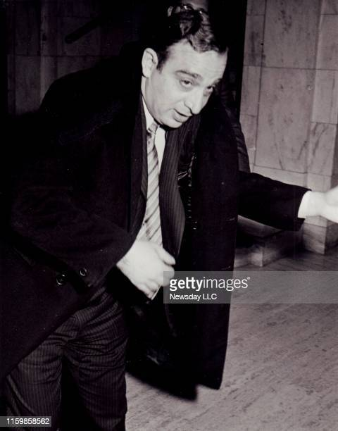 Carmine Persico a captain in the Colombo crime family puts on his coat after leaving a state legislative hearing on mob activities in Manhattan on...