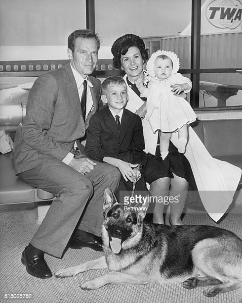 New York, NY- Charlton Heston arrives at New York's Idlewild Airport with his wife, Lydia and two children, Fraser and Holly . Heston is en route to...