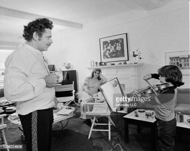Comedians Jerry Stiller and wife Anne Meara watch their son Ben Stiller practice the violin at the family's Upper West Side, Manhattan apartment on...