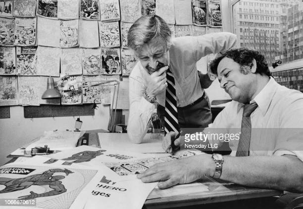 Comic book creator Stan Lee and artist John Romita go over a daily strip featuring Spiderman at their office on Madison Avenue in Manhattan New York...