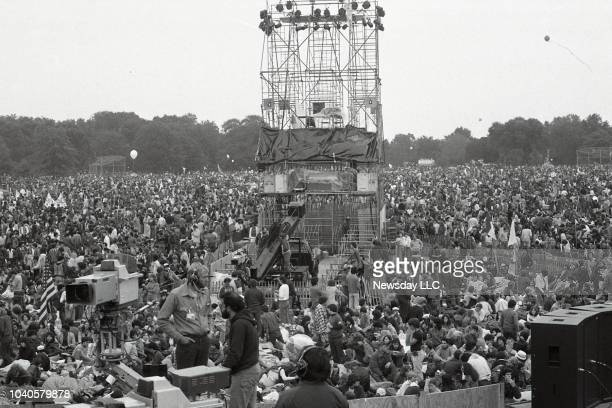 Crowds react as they listen to Paul Simon and Art Garfunkel perform on stage at the Great Lawn in Central Park in Manhattan on September 19, 1981. It...
