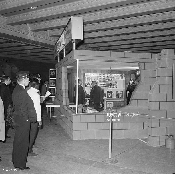 New York NY Cut away wall section shows glimpse of fallout shelter displayed in Grand Central station designed to accommodate family of 5 or 6 for...