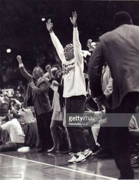 Director Spike Lee cheers the New York Knicks basketball team on to victory at Madison Square Garden in Manhattan on May 23 1993