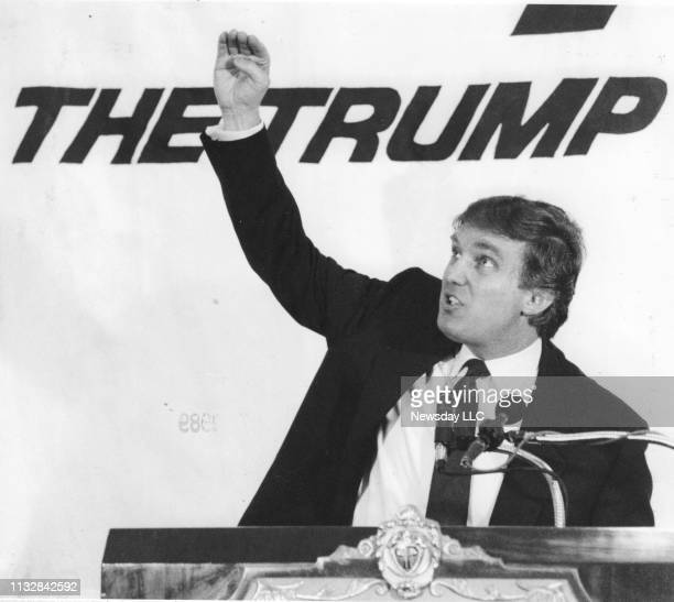 Donald Trump looks up from a podium where he discusses the Trump Shuttle at his hotel the Plaza Hotel in New York City on June 71989 Trump had...