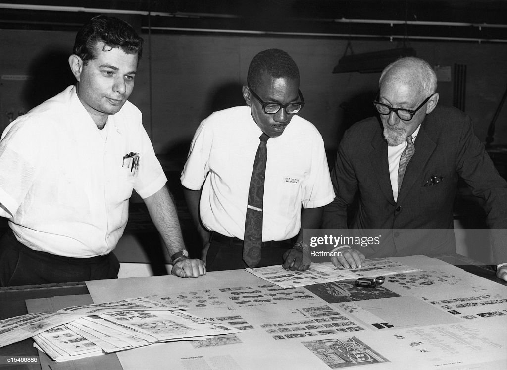 Dr. Otto Bettmann (R) at work with two unidentified people on the Bettmann Portable Archive. Undated photograph, circa 1960.
