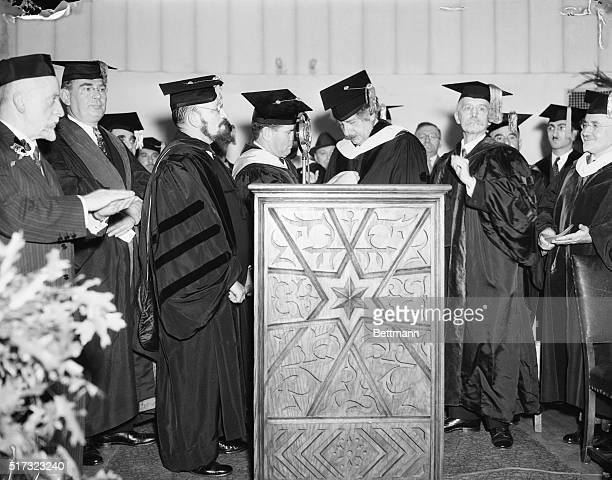 10/8/1934 New York NY Einstein receives honorary degree Dr Albert Einstein is pictured with Governor Hebert Lehman of New York left and B Revel...