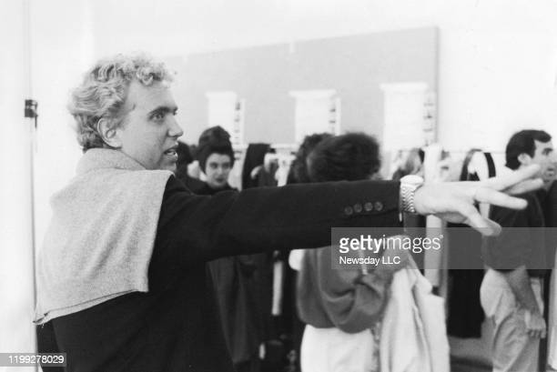 Fashion designer Michael Kors gestures toward part of his Spring 1987 collection in a studio off Ninth Avenue in the West Village in Manhattan, New...