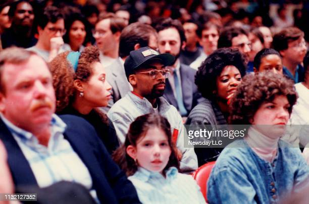 Film director Spike Lee watches his friend Mark Jackson of the New York Knicks basketball team play against the Washington Bullets at Madison Square...