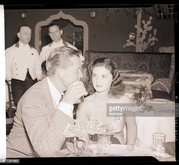 6/12/1939 New York NY Film player Bruce Cabot is pictured with socialite Brenda Frazier as they visited the El Morroco night club here June 12