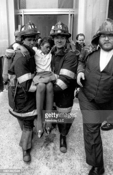 Firefighters carry a woman after an explosion at the World Trade Center in New York City on February 26, 1993.