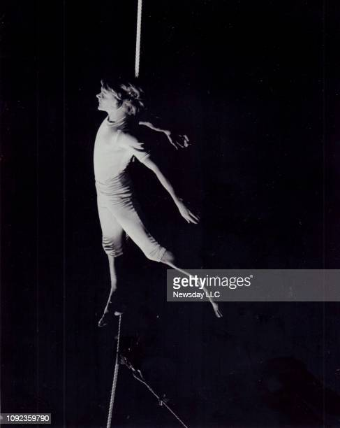 French high wire artist Philippe Petit performs at Madison Square Garden in New York City on May 8 his first performance after injuring himself...