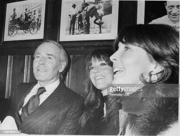 Henry Fonda sits with his daughter Jane Fonda and his wife Shirlee Fonda at a party that Jane hosted in his honor at Gallagher's on W 52nst Street in...