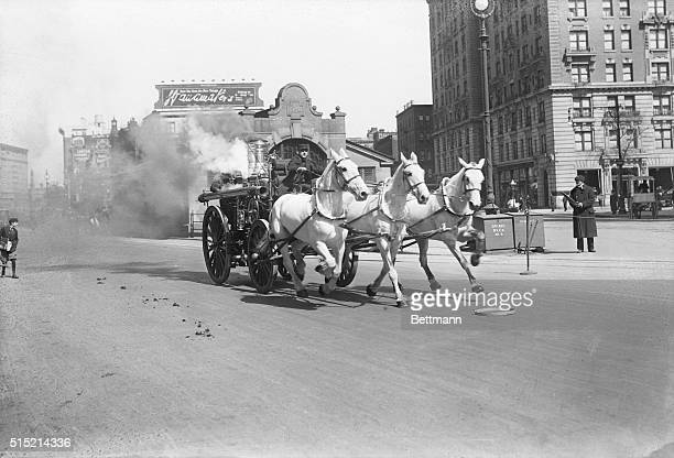 Horsedrawn fire engine at 72nd Street and Broadway New York City racing to a fire Photograph ca 1910