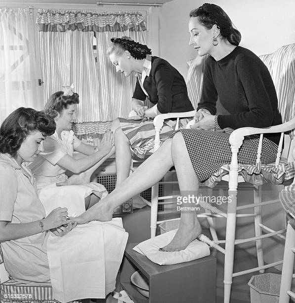 1943 New York NY If they had shoes on you'd think they were just getting a shine but actually Dana Jenney and Betty McLaughlen are having their...