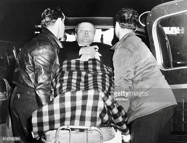 1/13/1956 New York NY Incapacitated 'Lear' Actor Orson Welles bears a look of pained resignation as he is lifted by attendants into an ambulance...