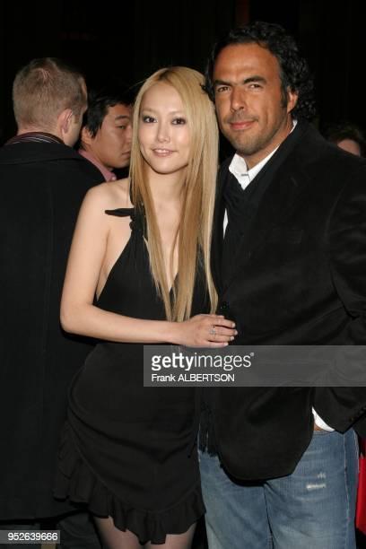 New York NY Jan 9 2007 Rinko Kikuchi and Alejandro Innaritu at the 2006 National Board of Review Awards Gala half length smile eye contact Frank...