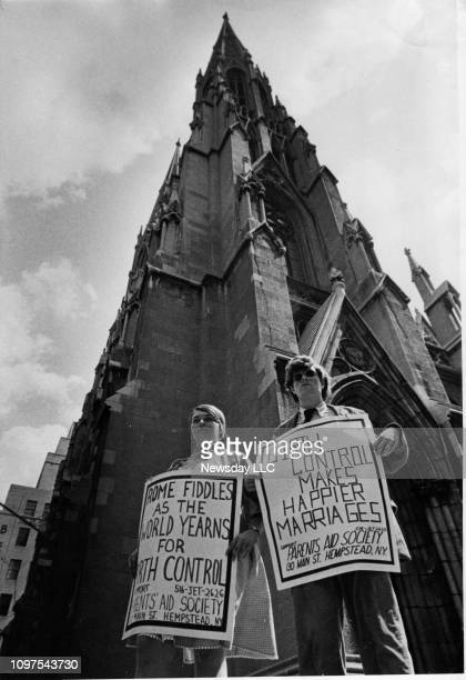 Jane Dexter of Garden City New York and Steve Reynolds of Rockville Centre New York stand in front of St Patrick's Cathedral with picket signs on...