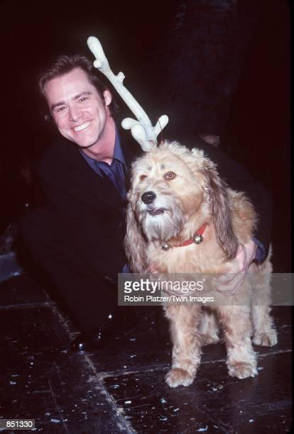 New York NY Jim Carrey with Max the dog at the Toy Fair Whobilation celebrating Universal Pictures'' and Imagine Entertainment's upcoming liveaction...