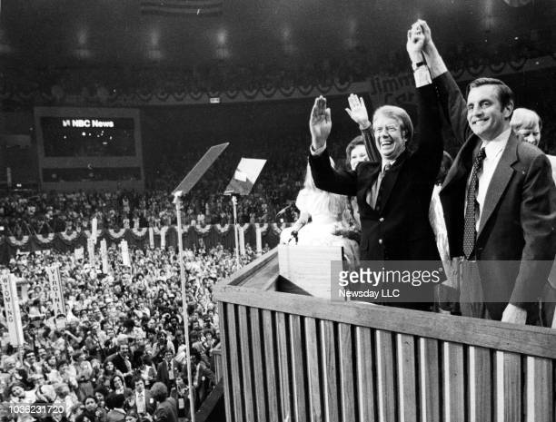 Jimmy Carter and Walter Mondale raise hands to an enthusiastic crowd after their acceptance speeches at the Democratic National Convention at Madison...