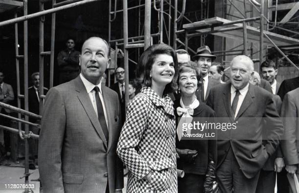 John Baur associate director of the Whitney Museum of American Art stands with Jacqueline Kennedy Flora Whitney Miller and Marcel Breuer the...