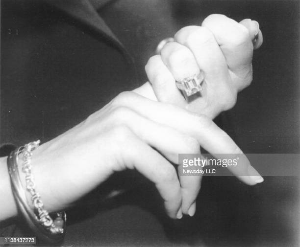 Marla Maples shows off her 745carat diamond engagement ring given to her by fiance Donald Trump at Macy's in Manhattan New York on December 14 1993