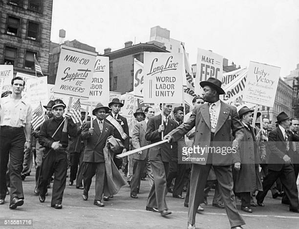 May Day parade in New York City in which wokers carry labor signs Photograph ca 1946