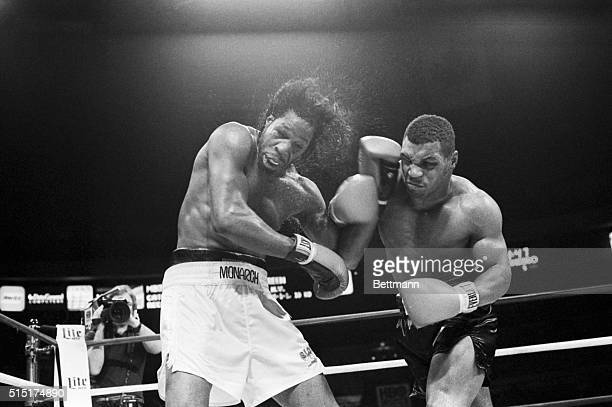 5/21/1986 New York NY Mitch Green's hair goes flying as undefeated Mike Tyson rocks him with a fistic barage during their 5/20 bout here Tyson won...