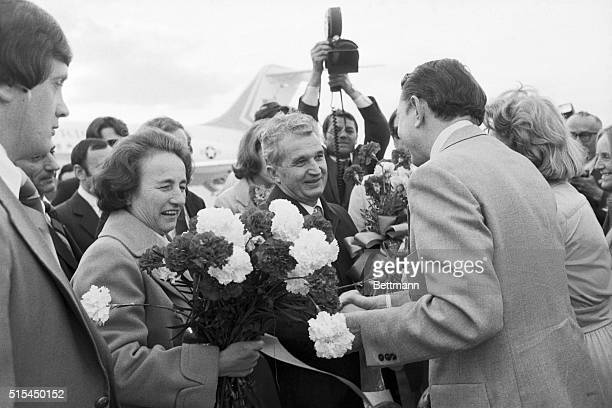 4/16/78 New York NY Mrs Nicolae Ceausescu wife of the Romanian president holds a bouquet of flowers while her husband is greeted by an unidentified...