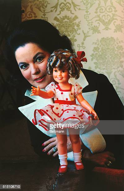 Mrs Shirley Temple Black the most famous child star ever displays the new version of the Shirley Temple doll so popular in the 1930's Out of...