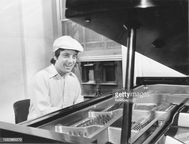 Musician Billy Joel plays piano in his Manhattan apartment on May 28 1976