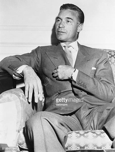 3/24/1954 New York NY Next A Poor Girl Playboydiplomat Porfirio Rubirosa tells newsmen in his Hotel Plaza room that the next girl he marries will be...