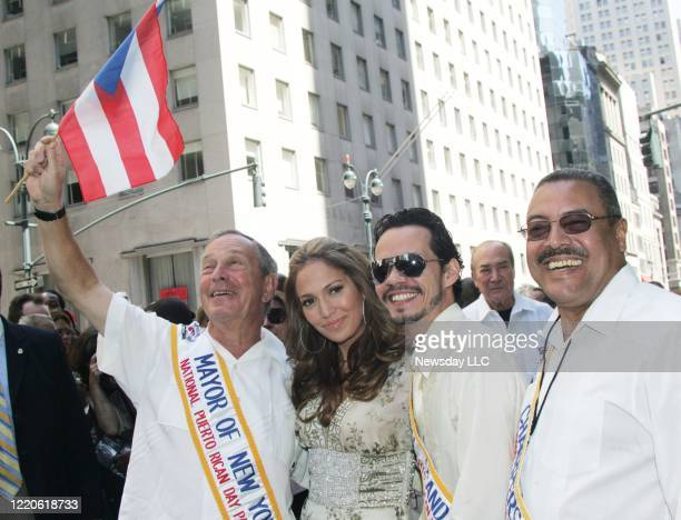 On June 11 NYC Mayor Michael Bloomberg waves a Puerto Rican flag as he Jennifer Lopez her husband parade Grand Marshall Marc Anthony and parade...