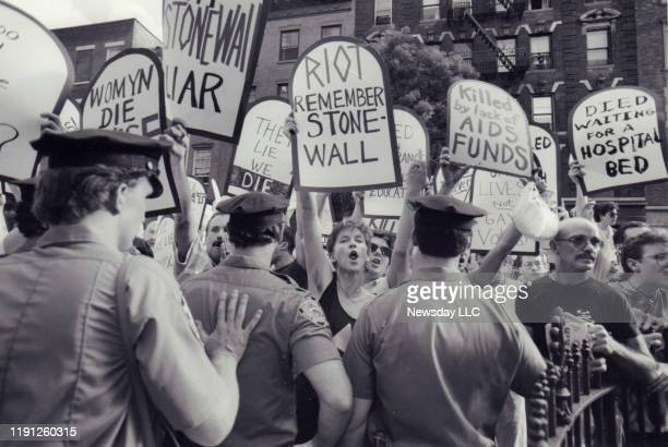 On June 6 AIDS activists protest during the dedication ceremony of Stonewall Place on Christopher Street in Greenwich Village New York