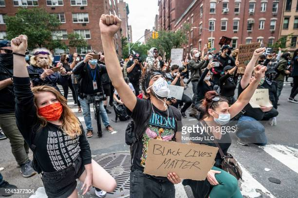 Protesters raise fists during a solidarity rally for George Floyd on June 2 in Manhattan Floyd died while in police custody in Minneapolis