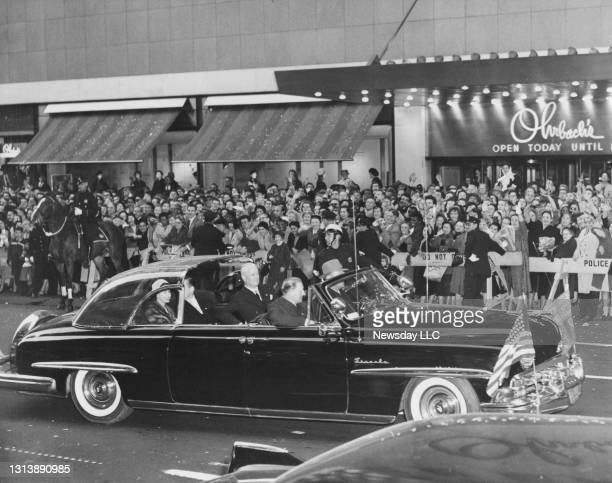 Queen Elizabeth ll and her entourage arrive at the Empire State Building during a visit to New York City on October 21, 1957.
