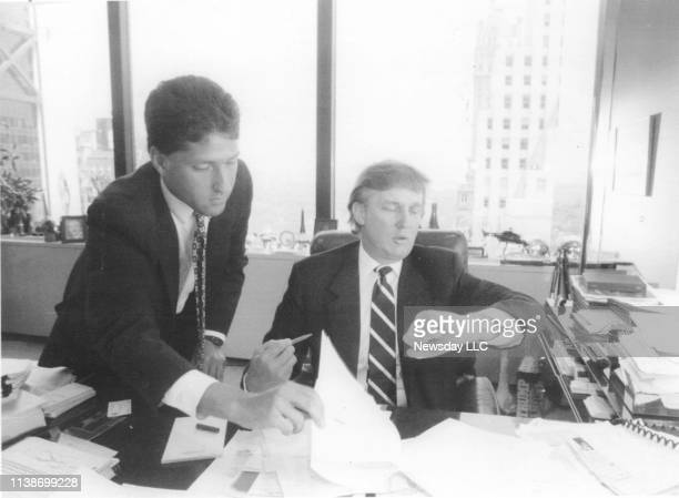 Real estate developer Donald Trump looks at his watch while working with Joseph Tahl, a real estate attorney in his office at Trump Plaza in New York...