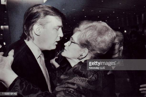Real estate executive Donald Trump embraces his mother Mary Trump at the opening of the first Galleries Lafayette in the United States at Trump Tower...