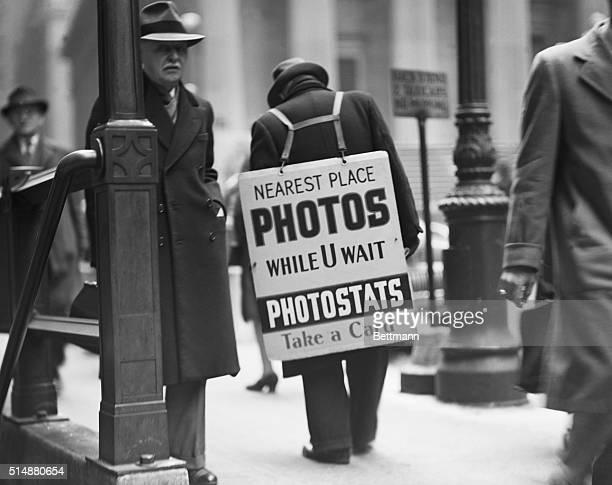 Sandwich man advertising photo studio in New York financial district ca 1950