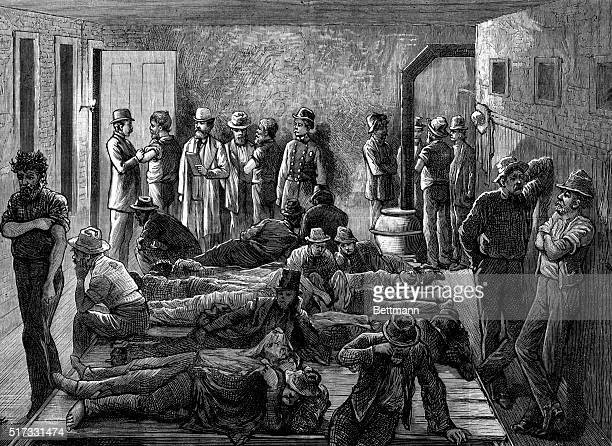 Sanitary precautions against a small pox epidemic NYC An inspector of the board of health vaccinating tramps in a station house 1879 Engraving