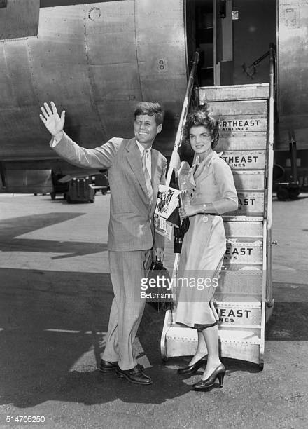New York, NY: Senator and fiancee off to Cape Cod. Senator John F. Kennedy of Massachusetts waves to friends at LaGuardia Airport, June 26th, before...