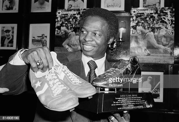New York, NY: St. Louis Cardinals' Lou Brock, the greatest base-stealer in the history of modern baseball, stops here enroute to spring training to...