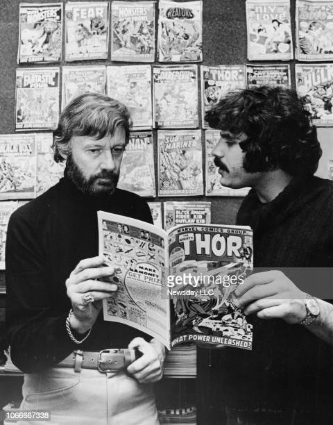 Stan Lee reads a comic book with Steve Lemberg at their office on Madison Avenue in Manhattan, New York on November 5, 1971 while working on adapting...