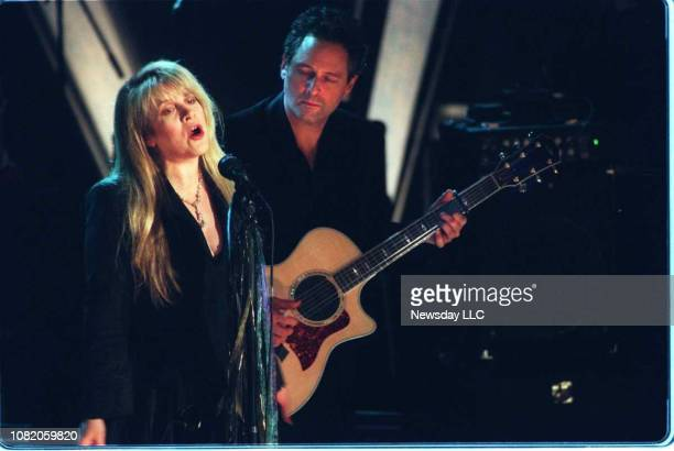 Stevie Nicks sings while bandmate Lindsey Buckingham looks on during a performance by Fleetwood Mac as the band is inducted into Rock Roll's Hall of...