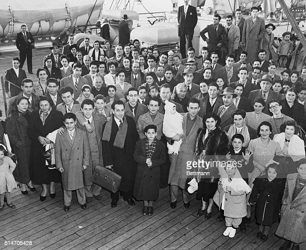New York NY 'Tempesttost' arrivals This large group of Italian immigrants gathers on the deck of the Italian Lines SS Conte Giancamano arriving in...
