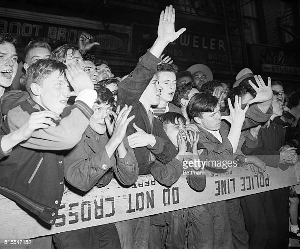 5/1/1951 New York NY The crowd along 8th Avenue heckles the Communist May Day parade in New York City Photo shows a group of boys pressed up against...