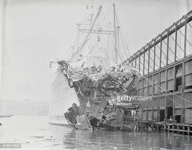 The mangled icecutting bow of the liner Stockholm gives grim evidence of its disastrous collision with the luxury liner Andrea Doria after docking at...