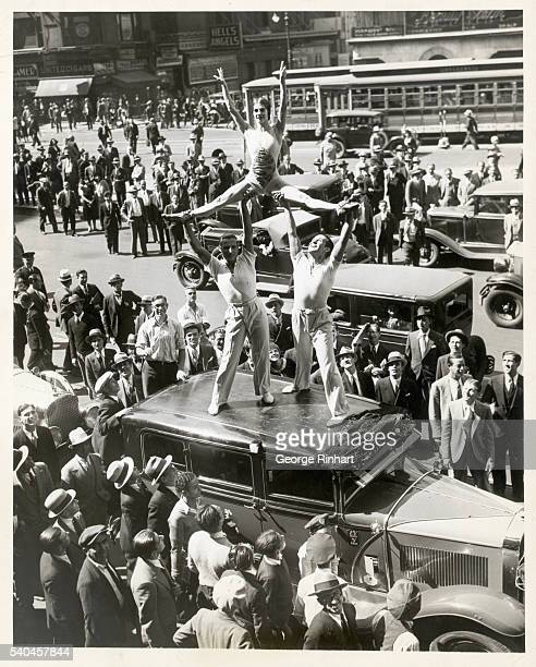 New York NY The roof of an automobile as a stage for a popular trio Theodore Enrica and unidentified performing a movement from the adagio dance as...