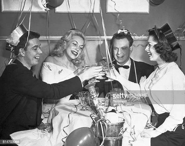 """New York, NY: Toasting in the New Year. It's time out from acting as these members of the """"Small Wonder"""" cast clink champagne glasses in a toast to..."""